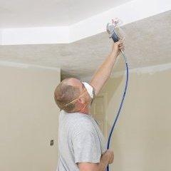 painter spray painting